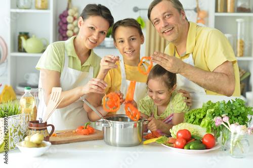 Obraz na plátně  Portrait of family cooking together in kitchen