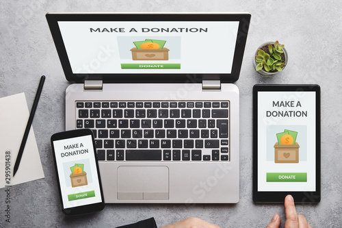 Donation concept on laptop, tablet and smartphone screen Canvas Print