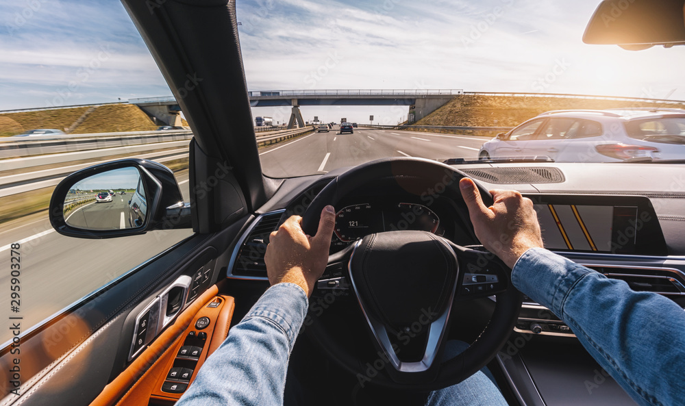 Fototapeta Driving car pov on a highway - Point of View, first person perspective