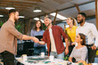 canvas print picture Young designers making deal with client and shaking hands