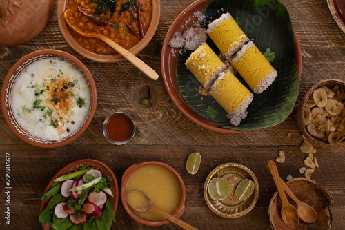 Vászonkép Traditional cholam puttu- Kerala steamed corn cakes served with kadala curry and
