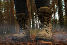 Hiking Boots On A Wooden Backg...
