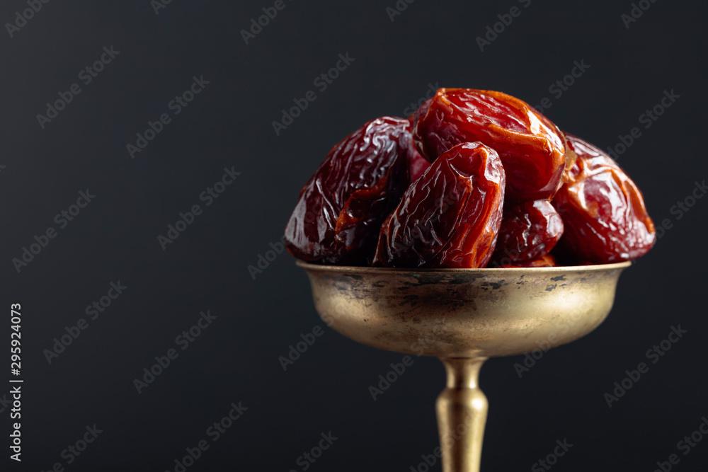 Fototapety, obrazy: Closeup sweet dried dates in brass dish.