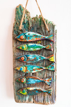Colorful Wooden Fish Art Hanging On White Background