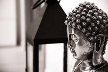 Greyscale Horizontal Shot Of A Silver Buddha Statue