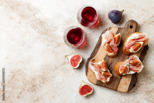 Crostini with prosciutto, cream cheese and figs on wooden board Wallpaper Mural