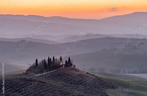 Keuken foto achterwand Lavendel The Tuscan countryside in the province of Siena shrouded in morning mist before the dawn of a new day