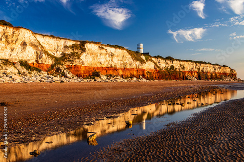 Stampa su Tela Light house reflection on the cliffs of Hunstanton Norfolk east Anglia England