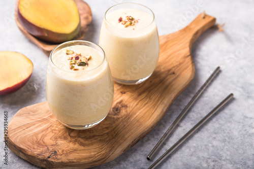 Mango Lassi, yogurt or smoothie. Healthy probiotic cold summer drink