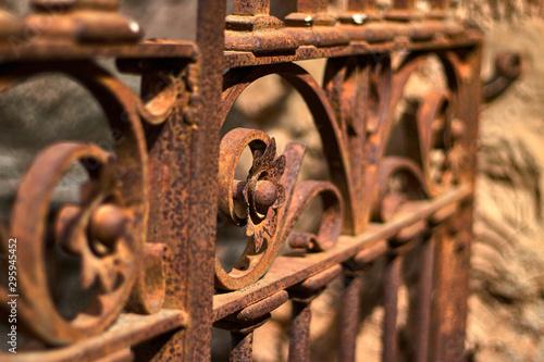 Beautiful rusty iron filigree in the street