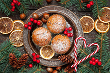Christmas Vanilla  Delicious Muffins Served On Ceramic Plate. Sprinkled With Powder Sugar