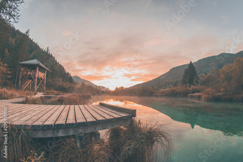 Foto op Aluminium Khaki Early morning in the nature reservate of Zelenci, Slovenia, the spring of Sava Dolinka river. Beautiful dreamy morning setting, fairy tale vivid colors and still lake visible.