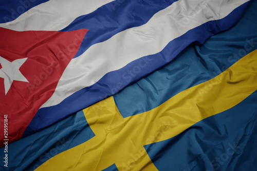 waving colorful flag of sweden and national flag of cuba. Canvas Print