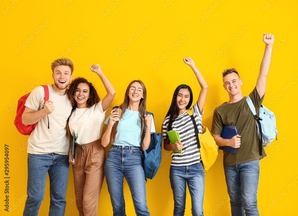 Fototapety, obrazy: Group of happy students on color background