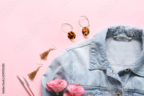 Pinturas sobre lienzo  Modern female jacket with stylish accessories on color background