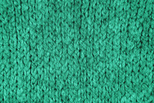 Loose Knitwear Fabric Texture With Wool Fibers. Repeating Machine Knitting Texture Of Warm Sweater. Trendy Mint Colored Knitted Background.
