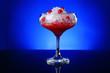 Leinwandbild Motiv Glass of tasty cocktail on dark color background
