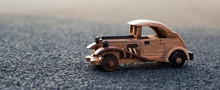 Old Retro Wooden Toy Car On The Road