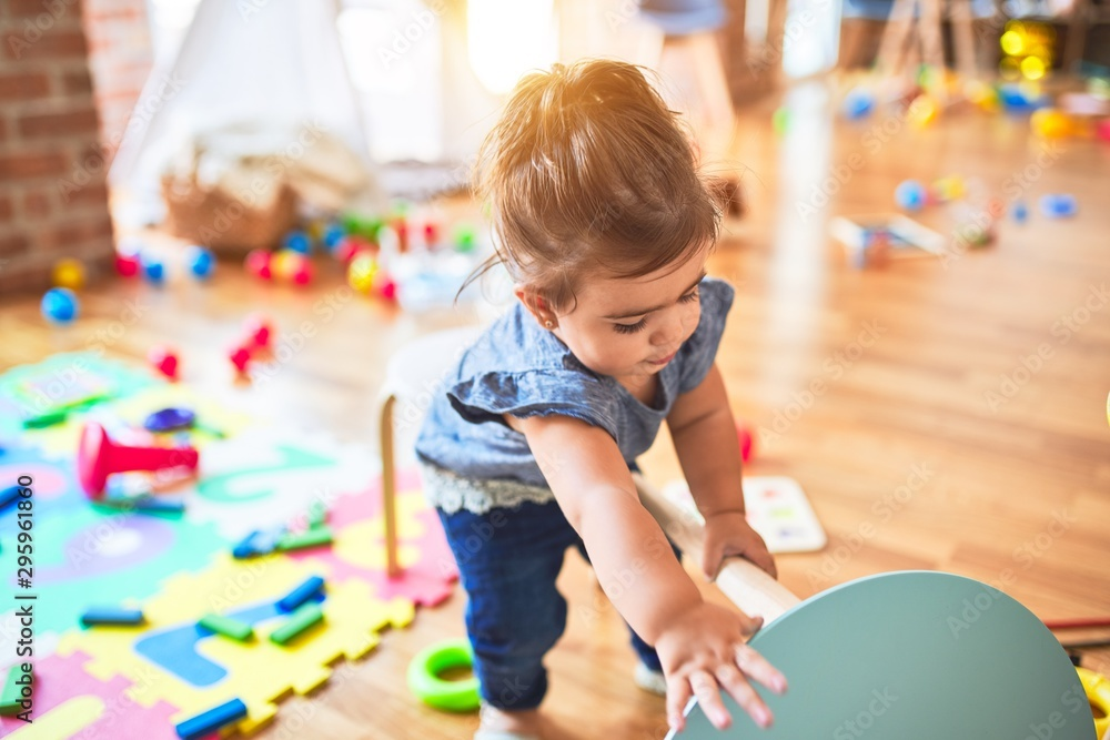 Fototapety, obrazy: Beautiful toddler throwing small table at kindergarten