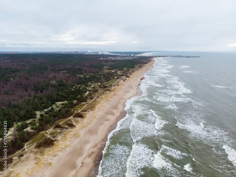 Fototapety, obrazy: Aerial view of the Baltic Sea shore line near Klaipeda city, Lithuania. Beautiful sea coast on chilly winter day.