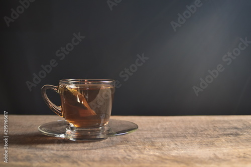 Spoed Fotobehang Thee Tea cup on old wood. Summer tea time