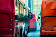 A Group Of Red Busses Urban Road Transportation
