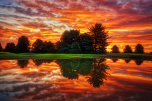 Dramatic Sunrise Clouds With Lake Reflection HDR