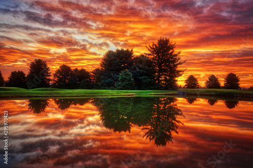 Foto auf Leinwand Braun Dramatic sunrise Clouds with Lake Reflection HDR