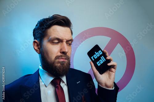 Photo Man frowning receiving telemarketing robo call