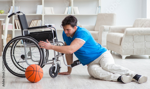 Fototapeta Young basketball player on wheelchair recovering from injury