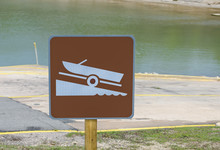 Boat Launch Sign At Boat Ramp On Lake