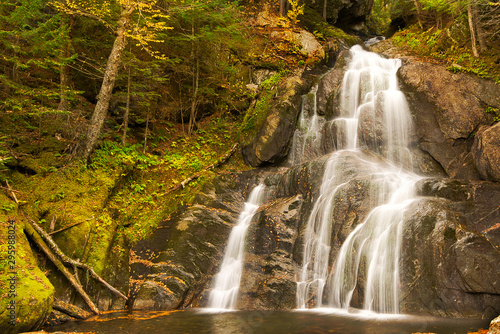 A waterfall in the fall full of fall or autumn colors in the forest