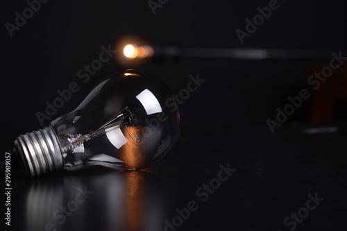 light bulb on black dark backgroun - 295989057