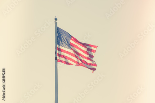 American flag on pole flowing in the wind Canvas Print
