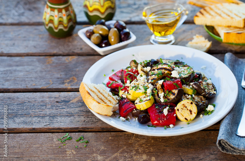 Fototapeta  Grilled vegetables salad with feta cheese in white plate