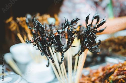 Foto auf Leinwand Peking Many fried scorpion on skewers at Yaowarat Road at Chinatown in Bangkok, Thailand. Street food in famous.