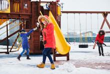 Children Having Fan With Snow ...