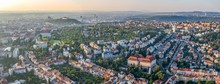 Wide Angle Aerial Panorama Of The City In Sunrise From Hot Air Balloon