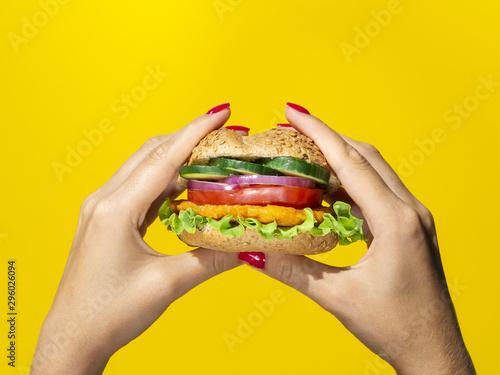Vászonkép  Close up view tasty burger on yellow background