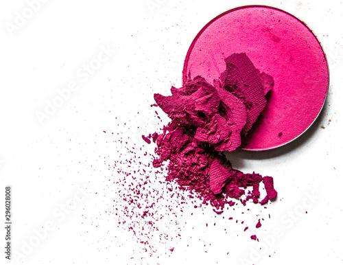 Crushed eyeshadow palette close-up isolated on white background