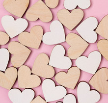 Creative Holiday Background Made From Wooden Hearts On Pastel Pink Backdrop