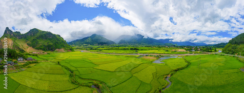 Photo sur Toile Les champs de riz Aerial view of Fansipan mountain hills valley on summer with paddy rice terraces, green agricultural fields in rural area in travel trip and holidays vacation concept, Sapa, Vietnam. Nature landscape.