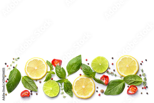Citrus fruits with different spices on white background Tableau sur Toile