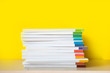 canvas print picture - Stack of colorful books on color background.