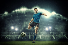 Soccer Player In Action On Nig...