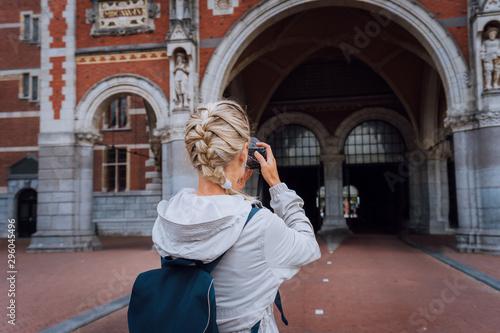 Woman tourist visiting museum in Amsterdam Wallpaper Mural