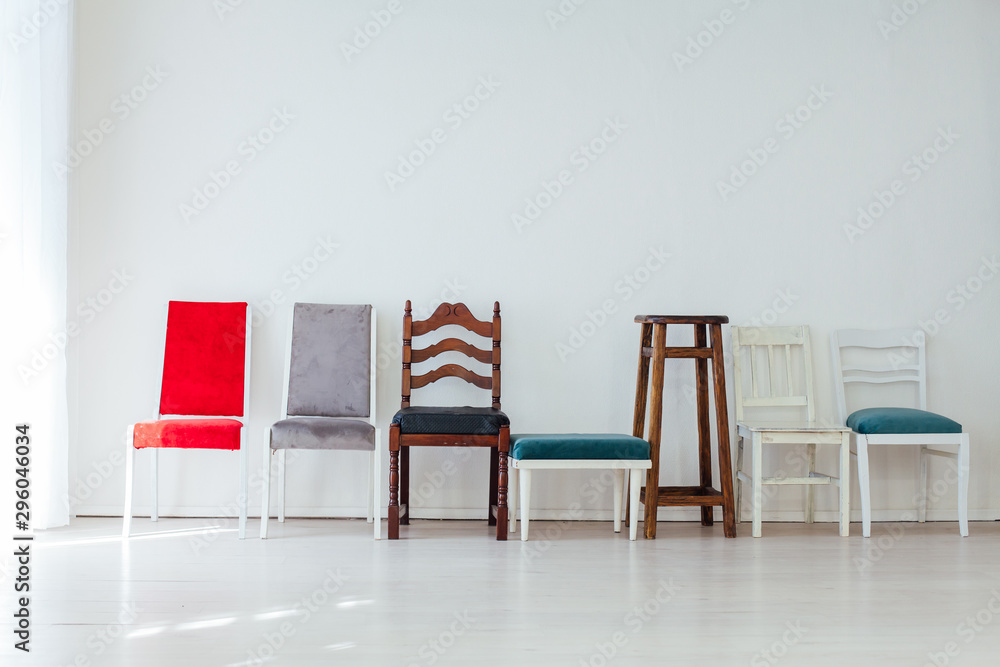 Fototapety, obrazy: many multicolored chairs stand in the white room