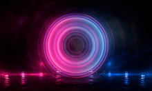 Neon Circle On The Background Of A Dark Old Brick Wall, Street, Wet Asphalt. Blue And Pink Neon, Smoke, Smog. Night View Of The Street With Neon. Abstract Neon Dark Background.