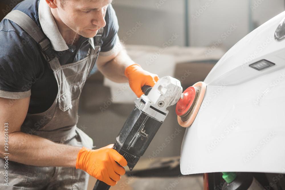 Fototapety, obrazy: Polished white car. polishing machine for polish finishing.