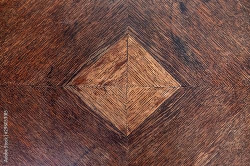 Fényképezés  old furniture piece of dark wood with light brown square inlay